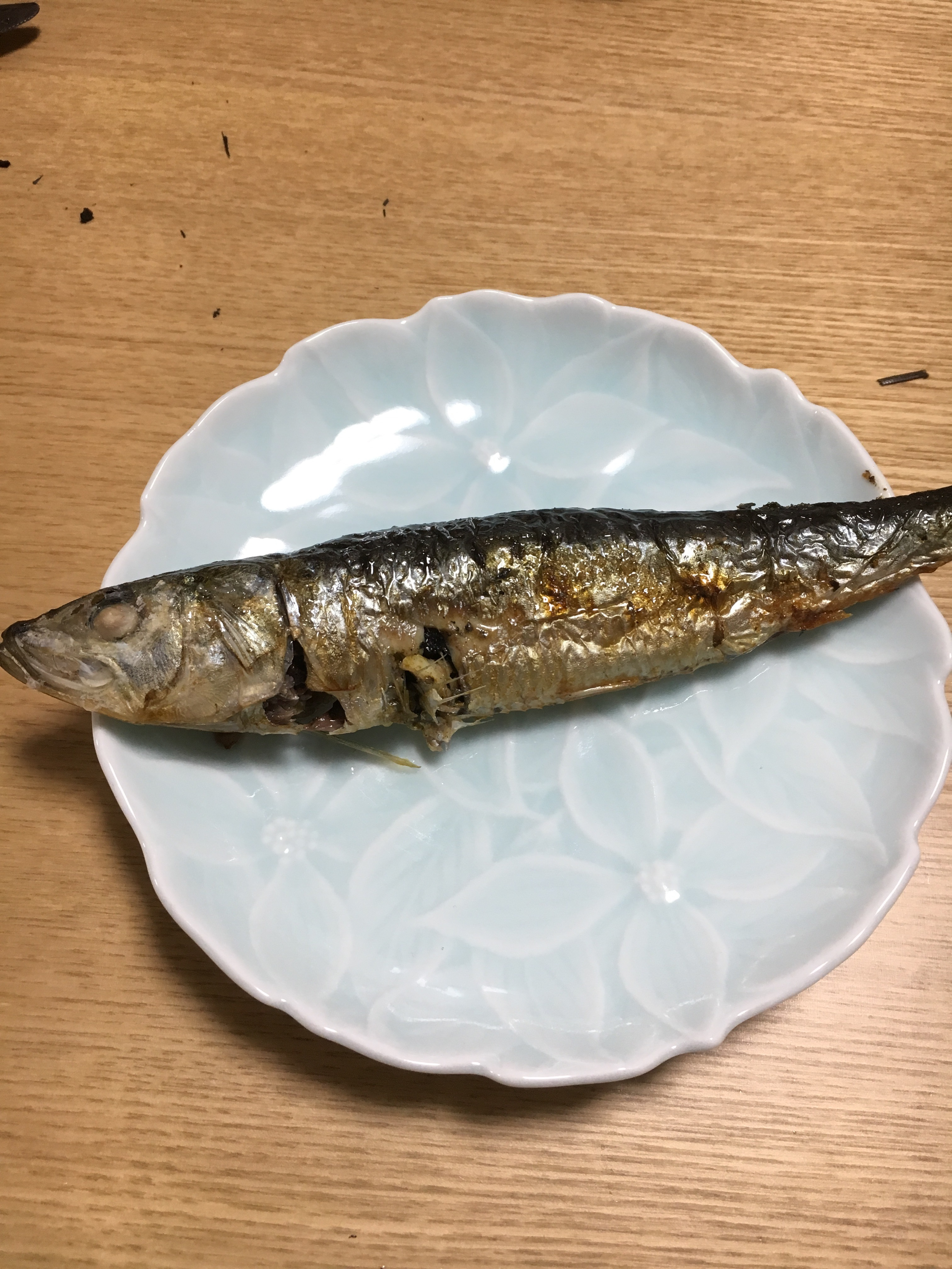 small grilled fish on a blue plate