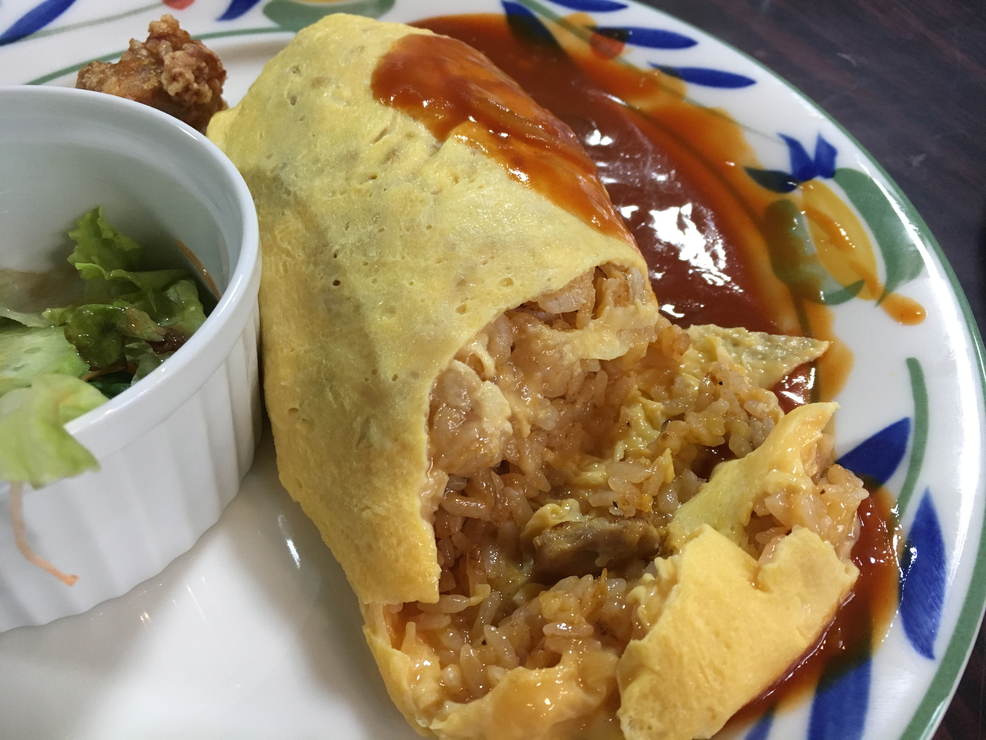 inside of omurice with a side of sauce