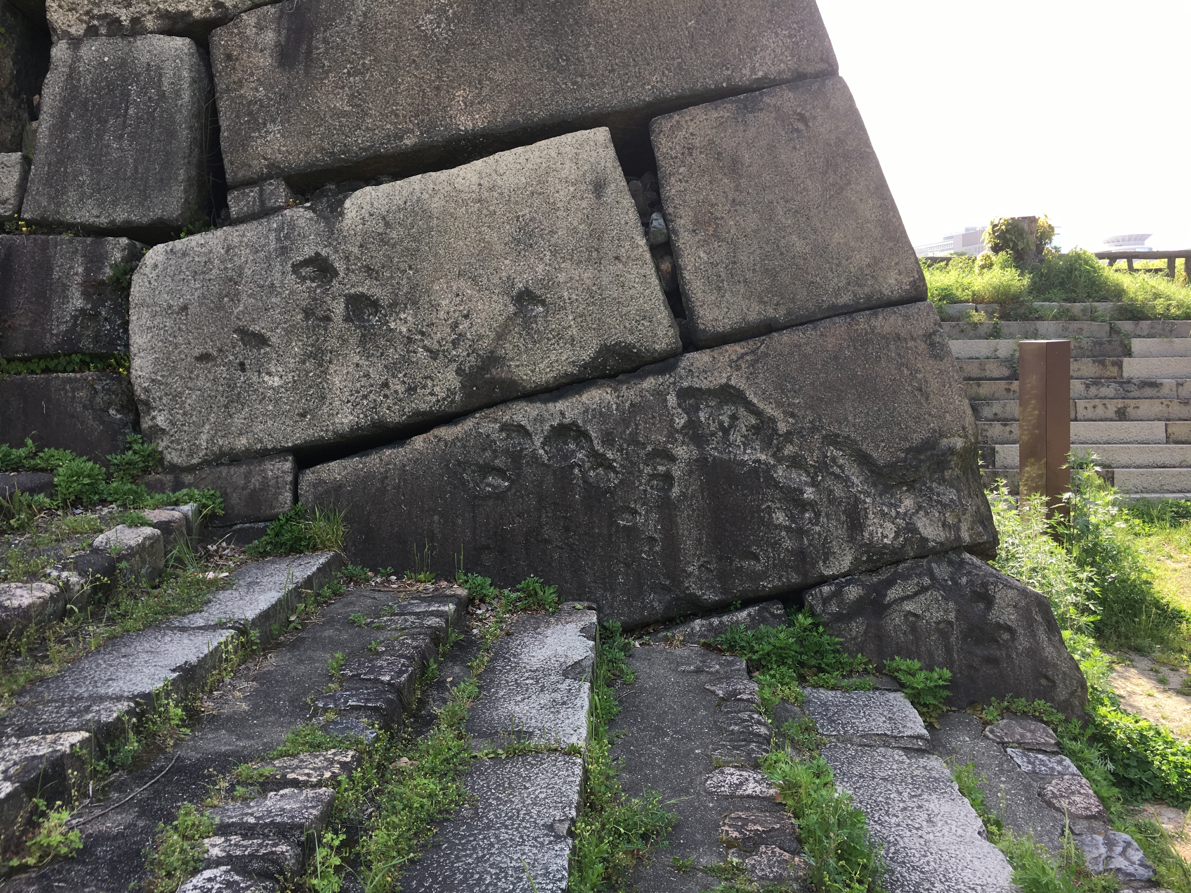 large stones with bullet marks from world war II and stone steps