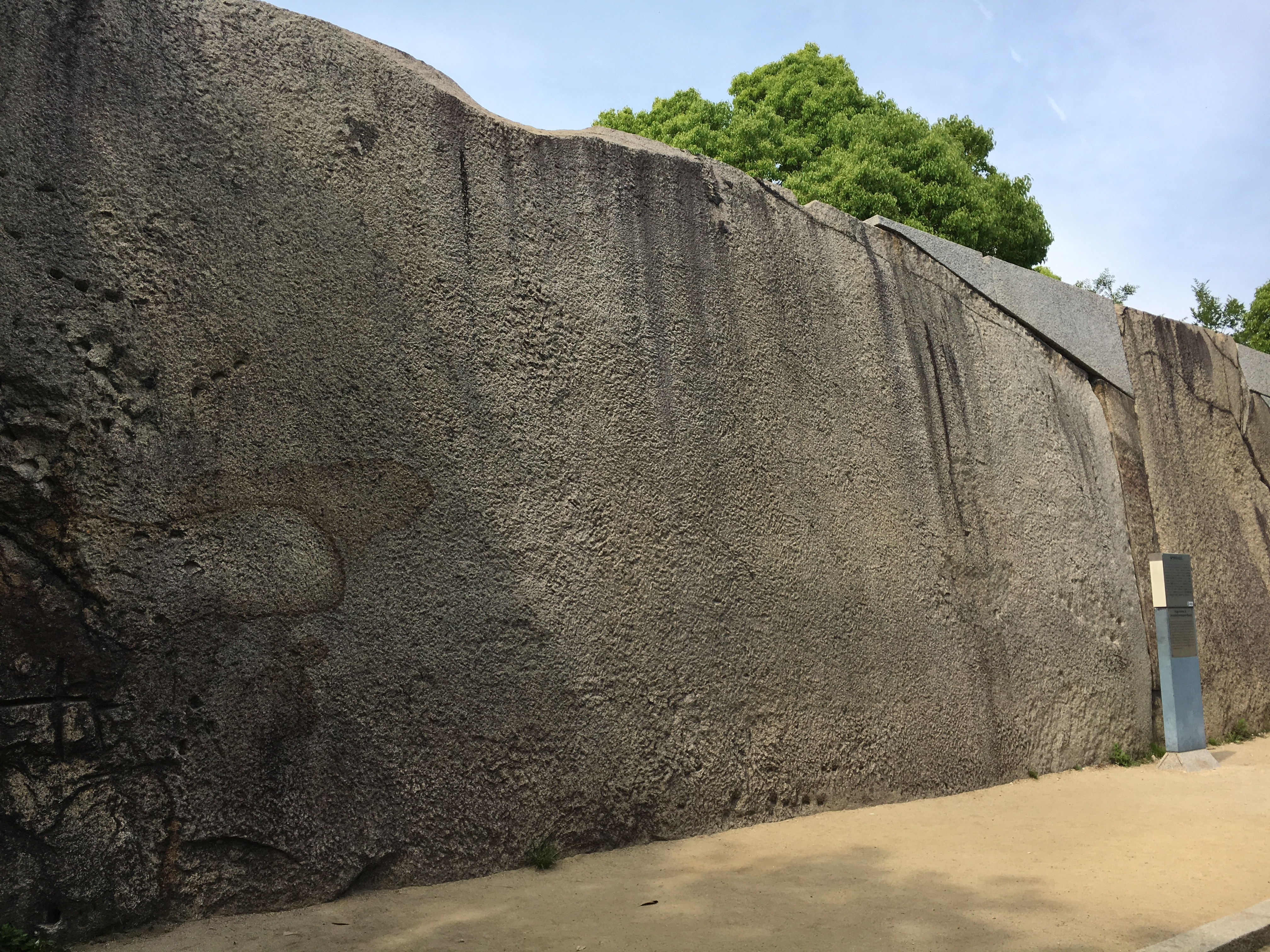 large stone at Osaka castle that has the outline of an octopus