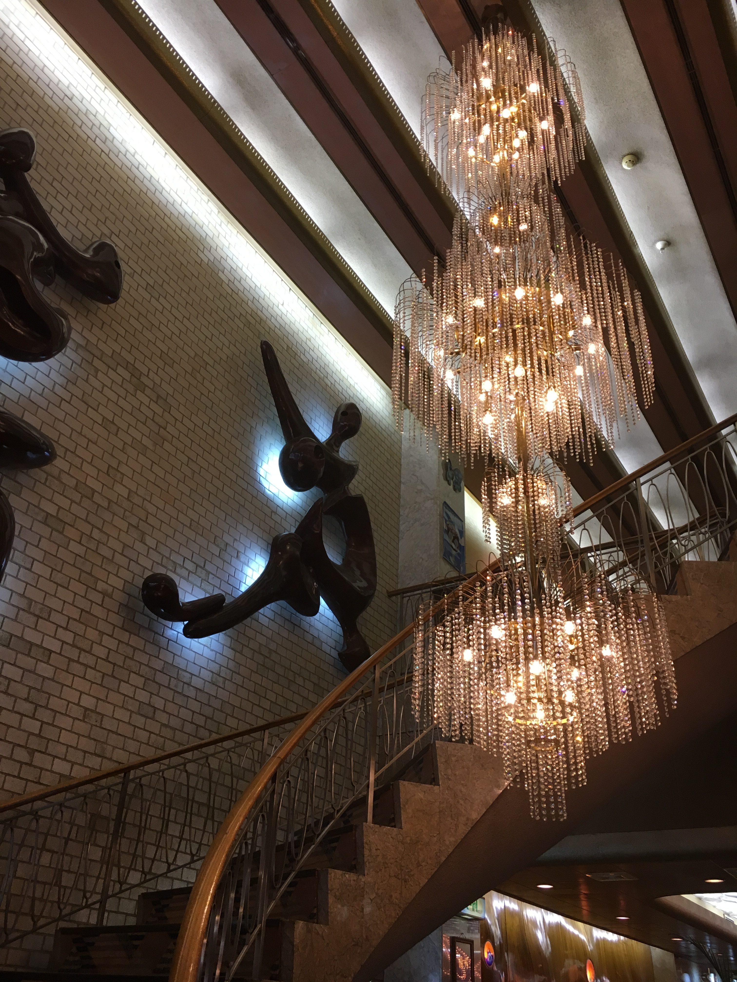 retro style chandelier and spiral stairs in dim cafe