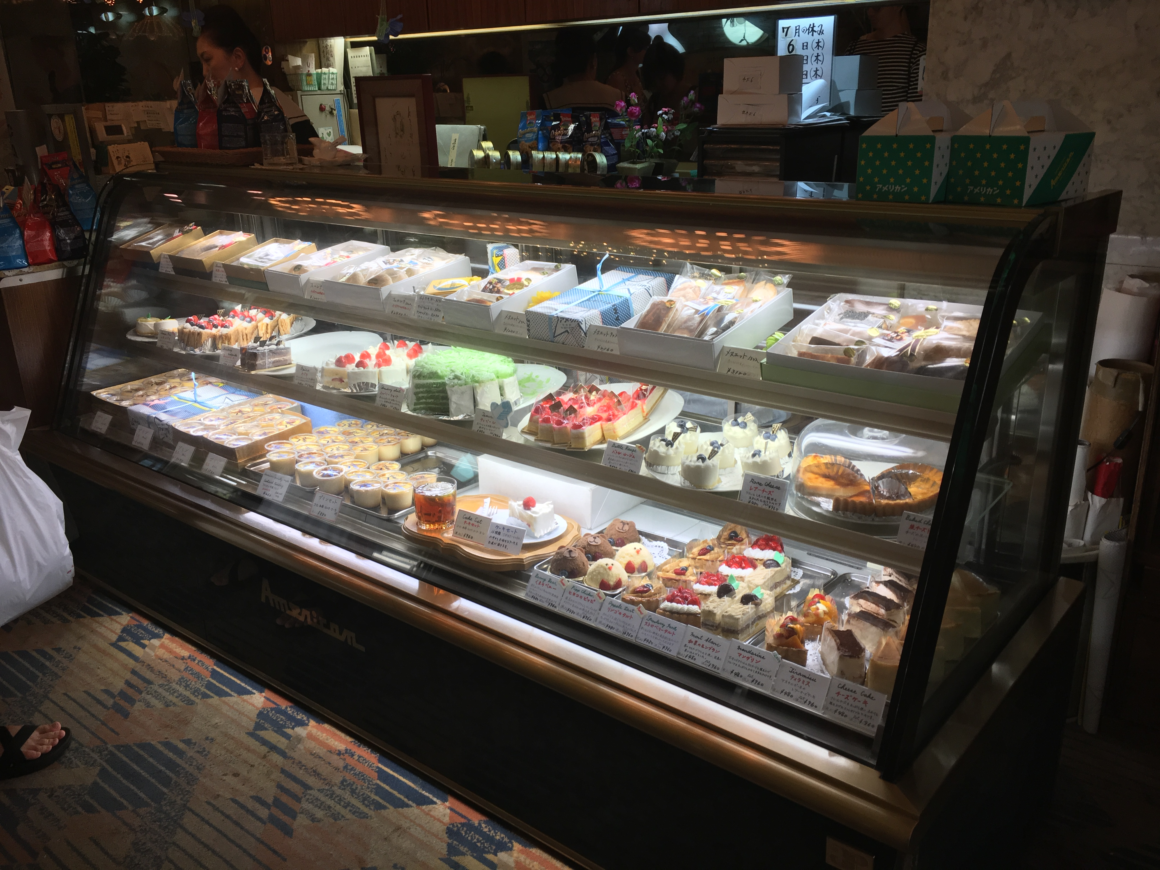 Kissa American dessert case featuring many different cakes and sweets