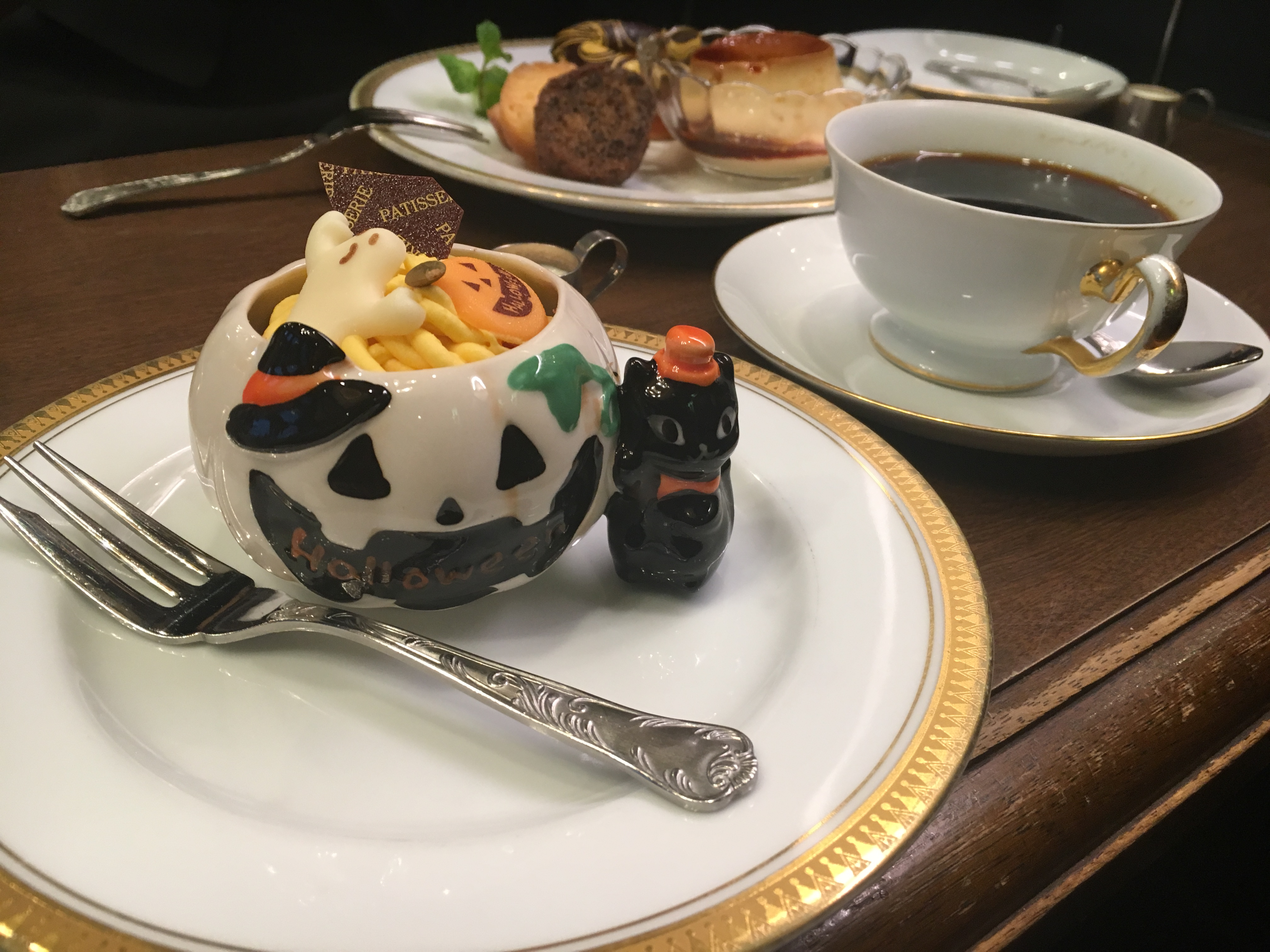 Halloween special kabocha cake set in Halloween dish with coffee