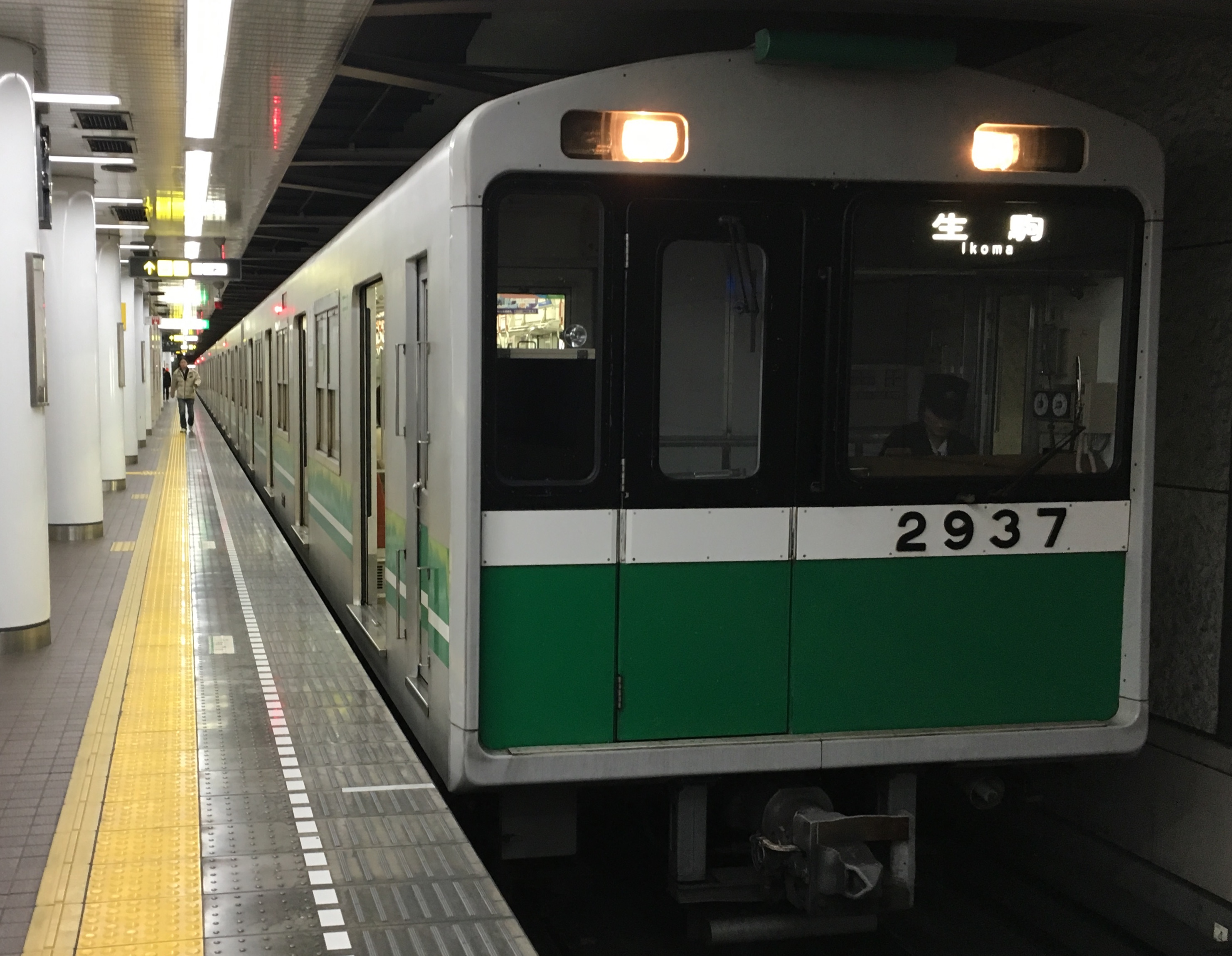 green and silver chuo train waiting to depart from station in Osaka