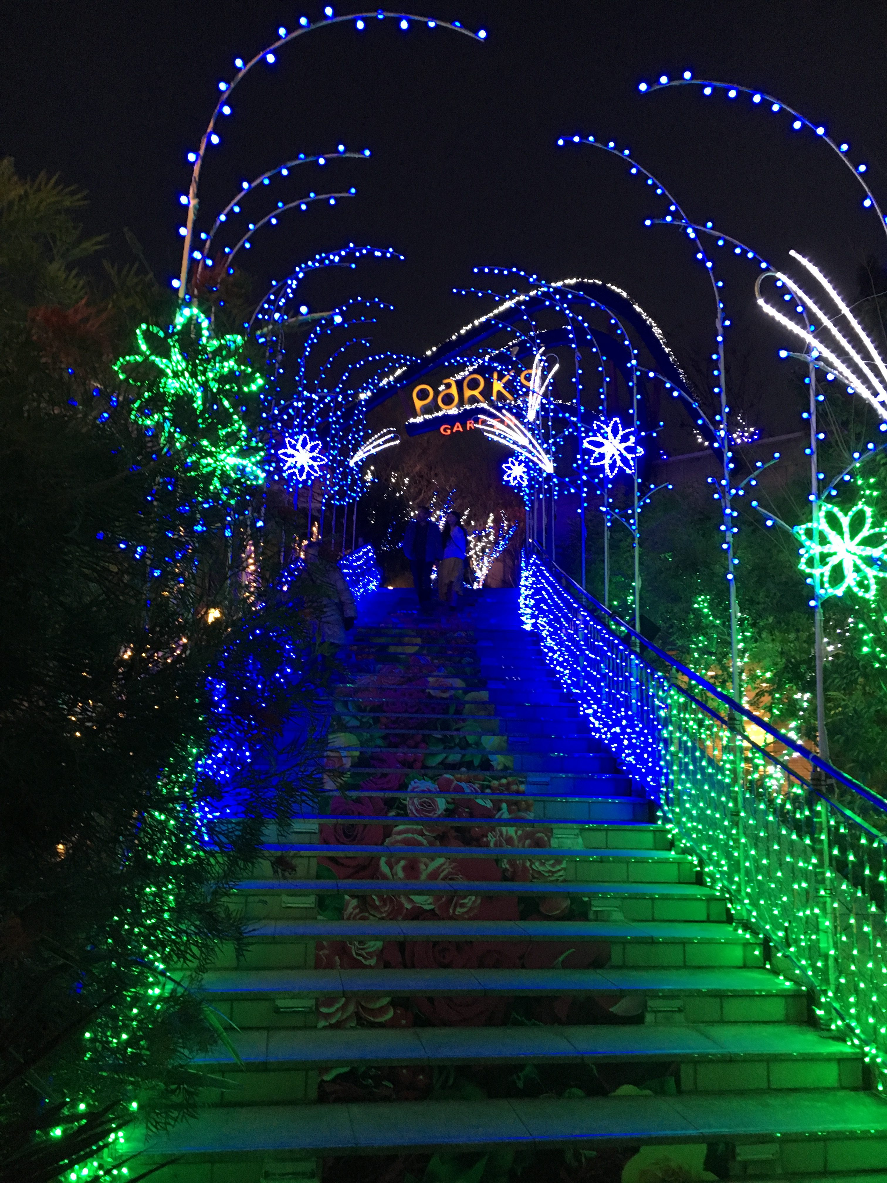 namba parks sign covered in blue and green lights