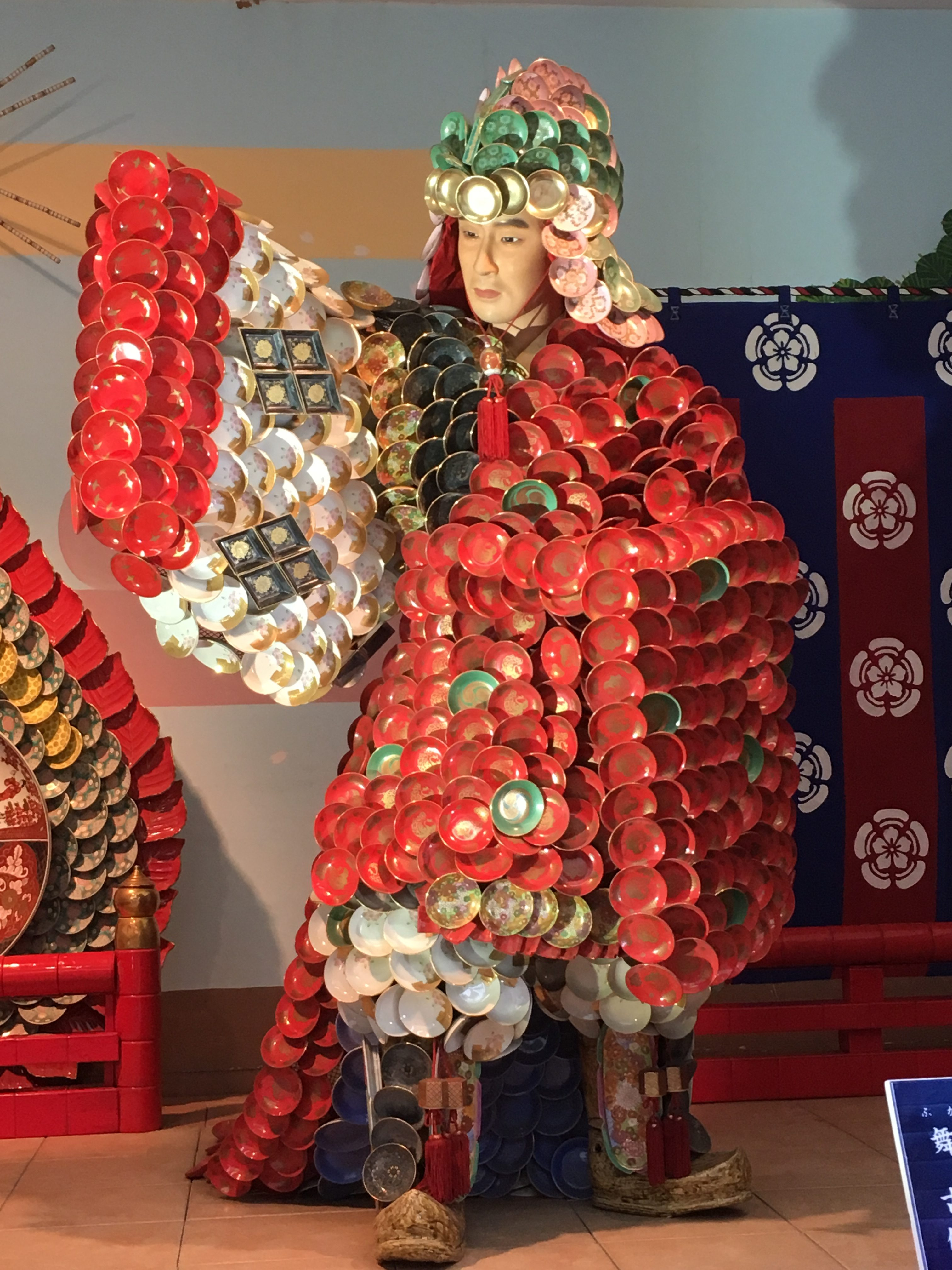 Life-size porcelain doll of a japanese lord covered in small porcelain dishes at setomono matsuri