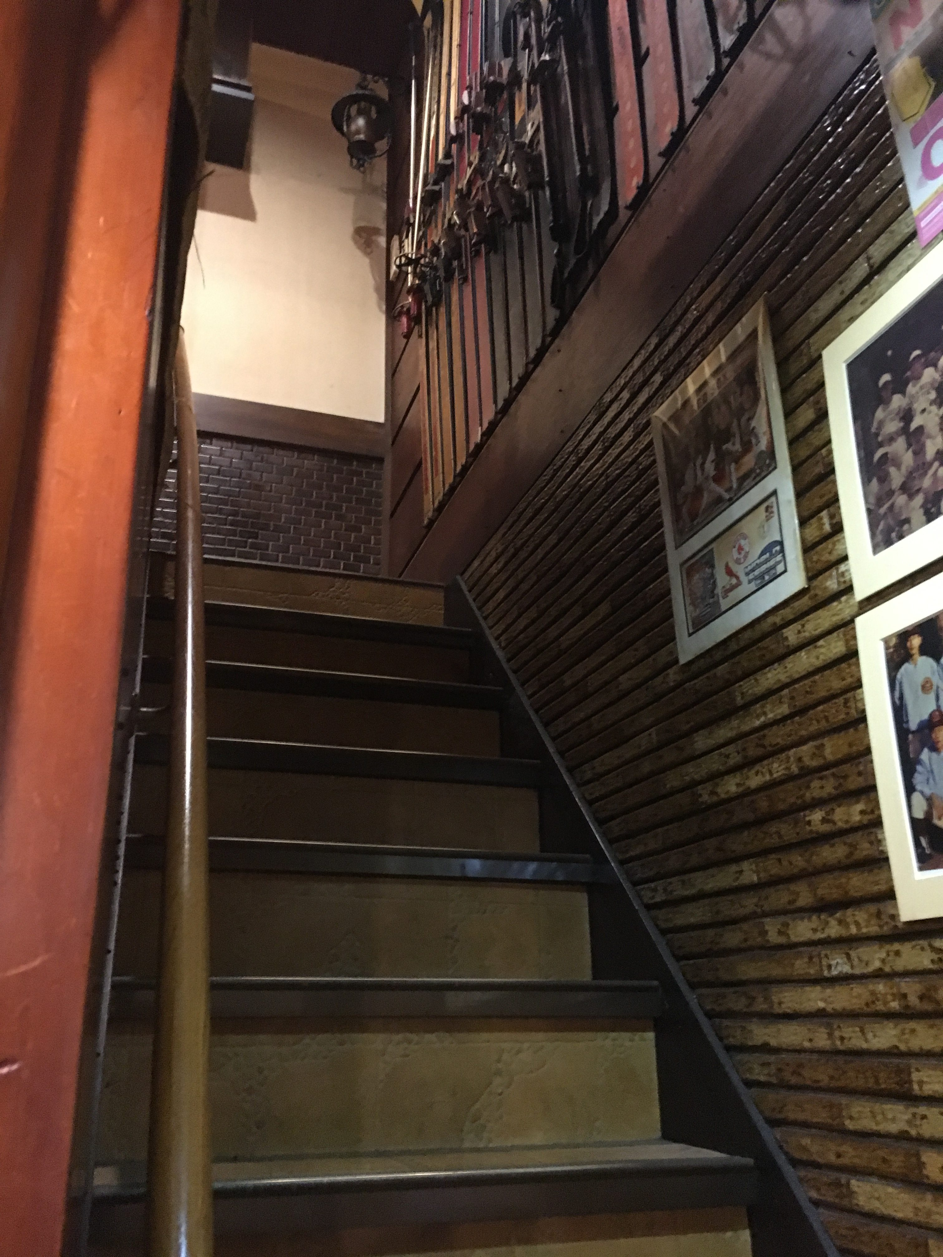 stairs leading up to the second floor of arabiya coffee