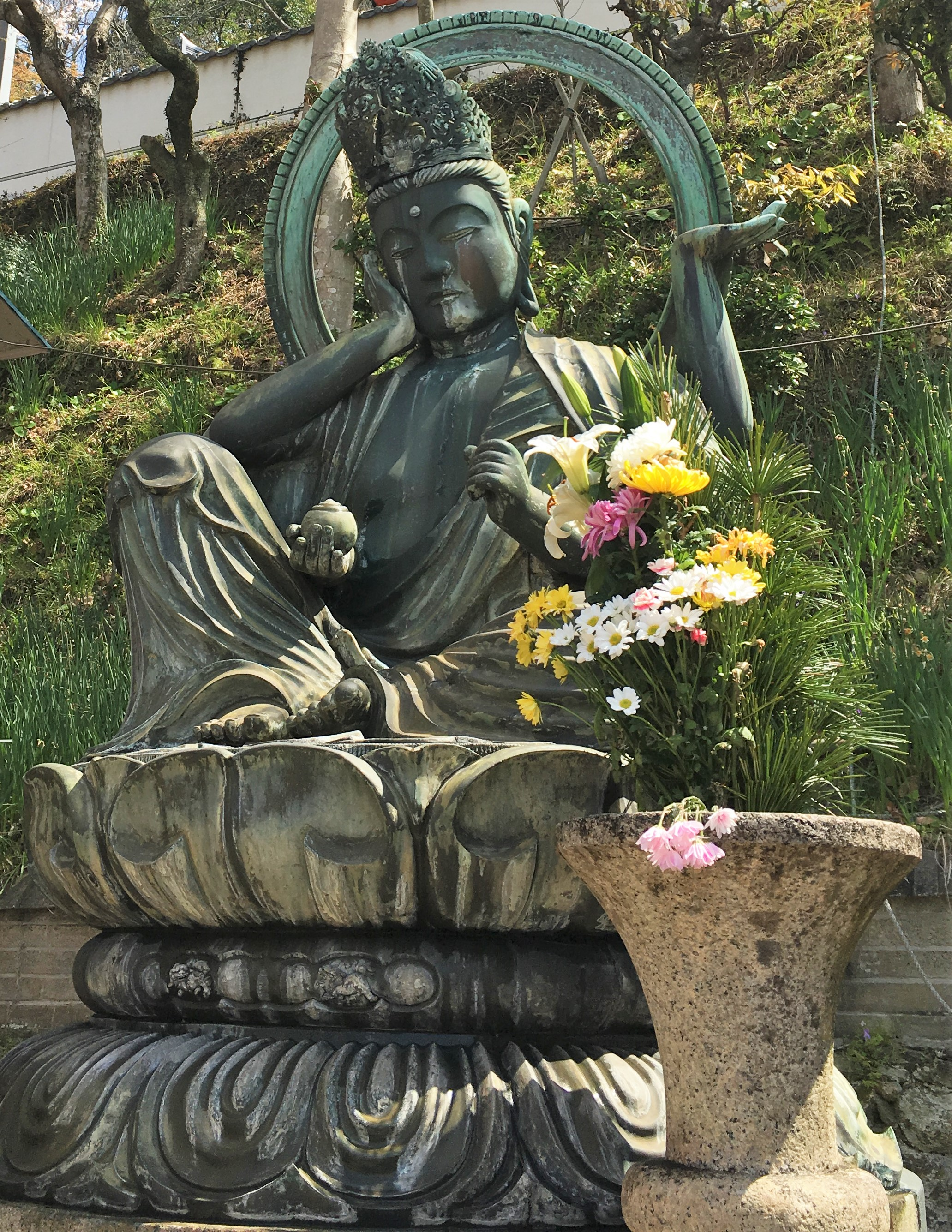 metal statue of nyroirin kannon in kimii-dera temple