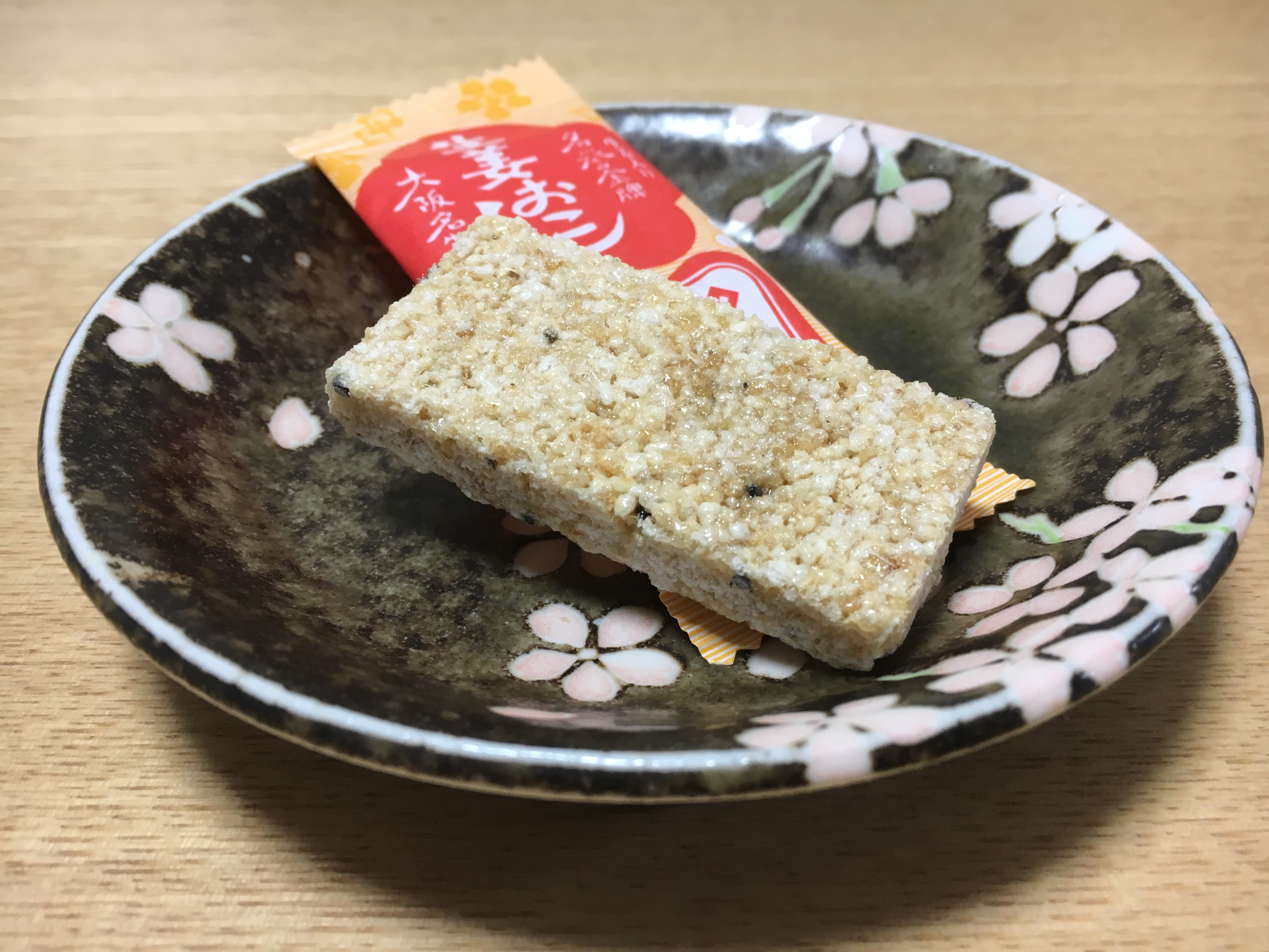 ginger flavored okoshi snack on a black plate from Futatsuido Tsunose