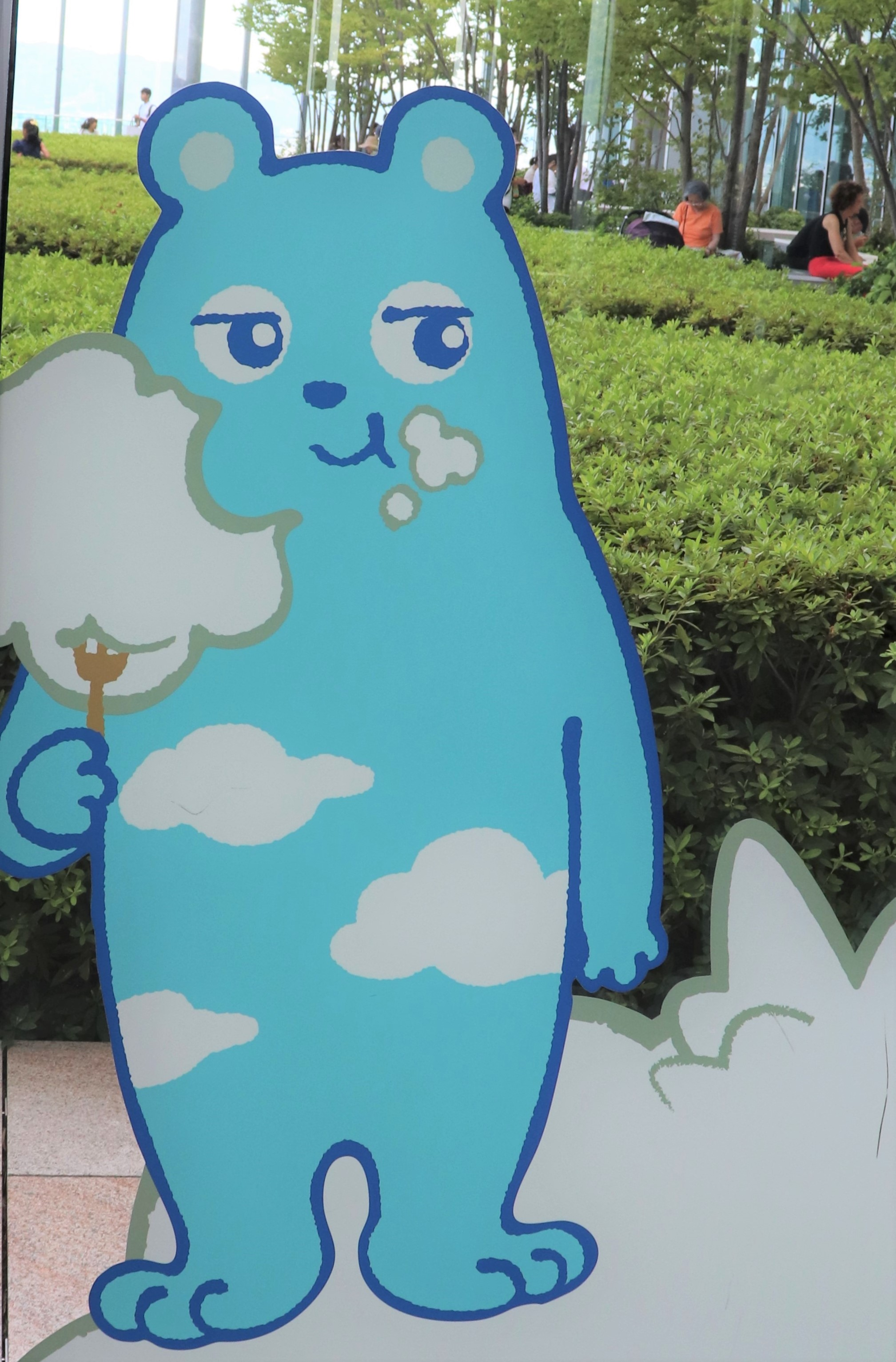 abeno bear eating clouds as cotton candy