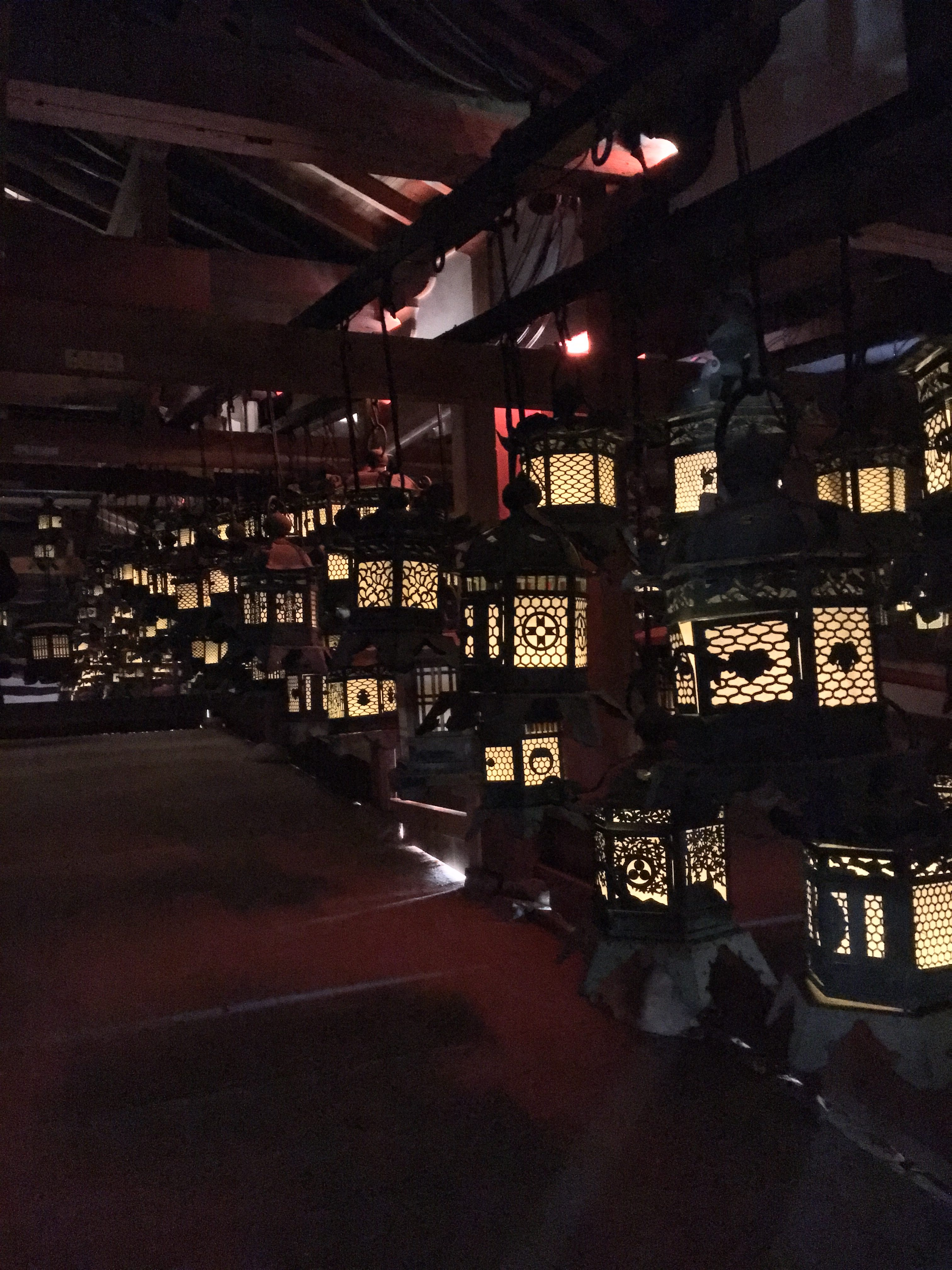 dark room with glowing lanterns in Kasuga Taisha