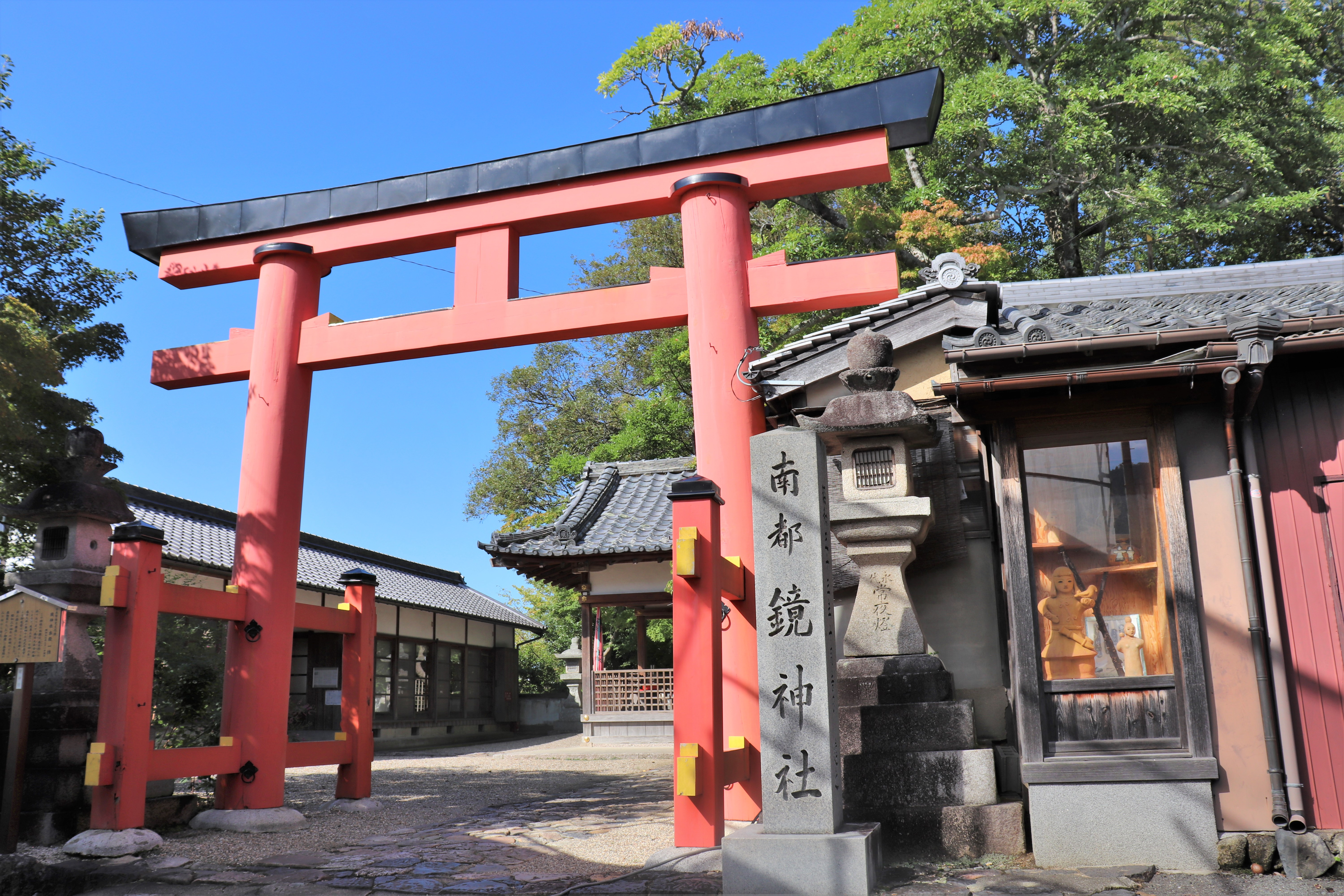 vermillion torii at the entrance of Kagami shrine in nara