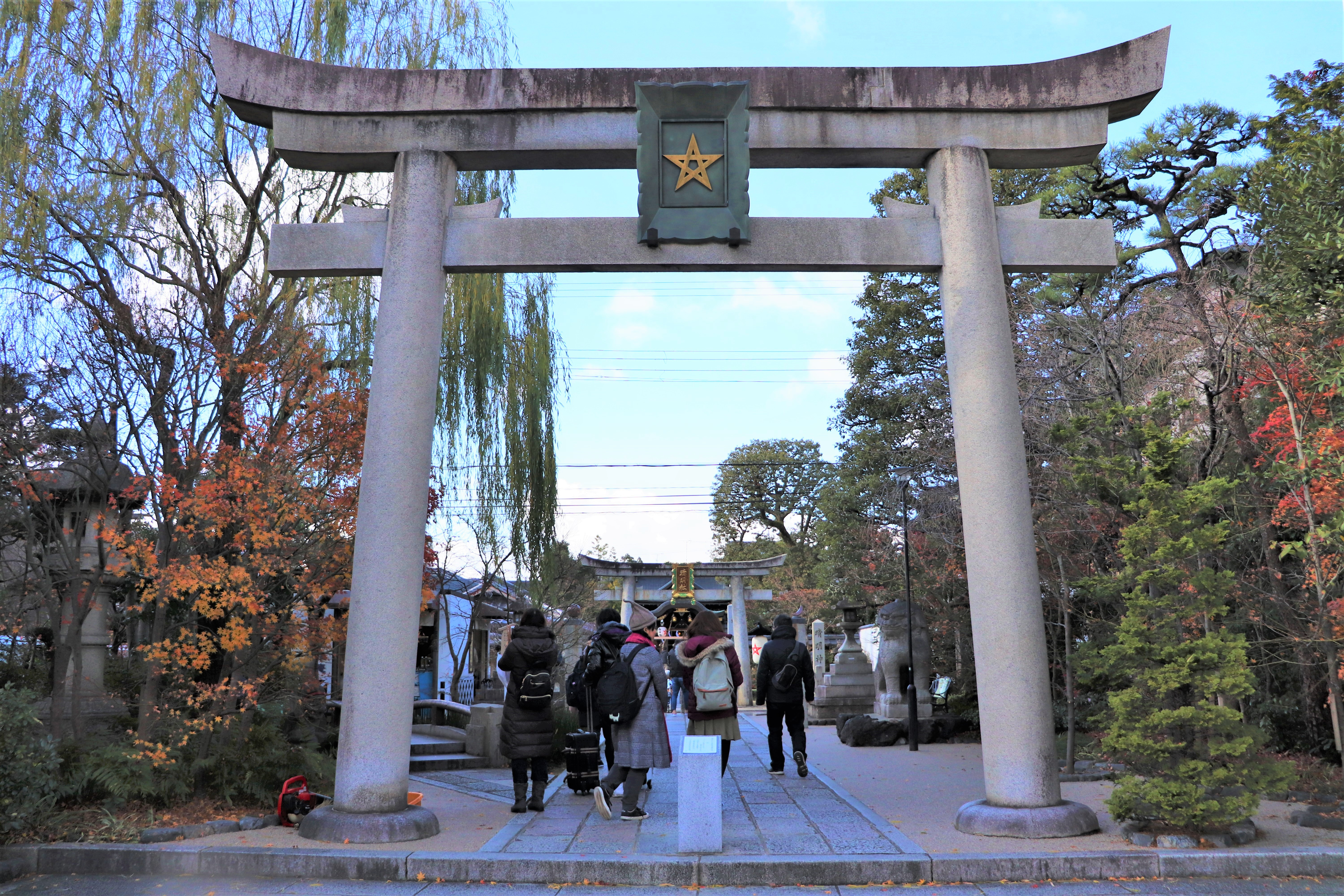 stone torii bearing the mark the Abe no Seimei at the entrance of Abe no Seimei shrine